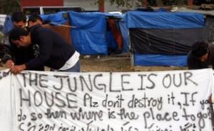 inmigrantes pancarta jungla